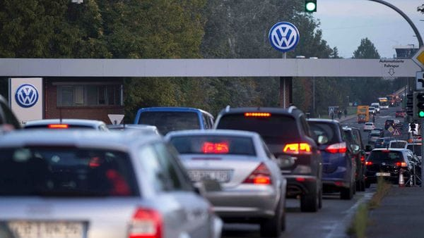 FILE PHOTO: Cars drive through the Sandkamp Gate to the Volkswagen factory in Wolfsburg, Germany. (Image used for representational purpose) (REUTERS)