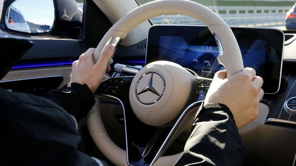 File photo of the logo of Daimler's Mercedes-Benz on a steering wheel (REUTERS)