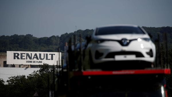File photo - A car carrier transporting Renault ZOE leaves the Flins plant of French carmaker Renault in Aubergenville, west of Paris. (REUTERS)