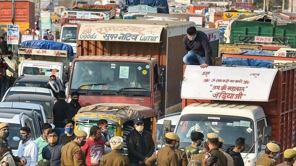 Police stand guard on the Singhu border as farmers march towards Delhi as part of Delhi Chalo protest. (PTI)