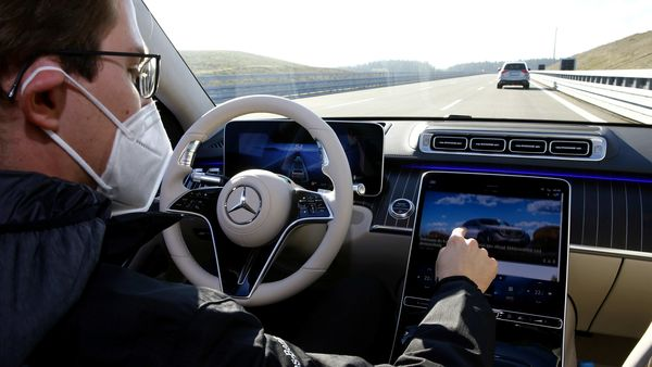 An employee of Daimler demonstrates steering by the Drive Pilot Level 3 autonomous driving system in a new Mercedes-Benz S-Class limousine. (File photo) (REUTERS)