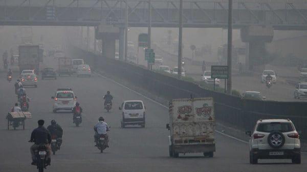 Vehicles moving at Delhi-Gurugram Expressway amid smog, in Gurugram on Thursday. (ANI PHOTO)