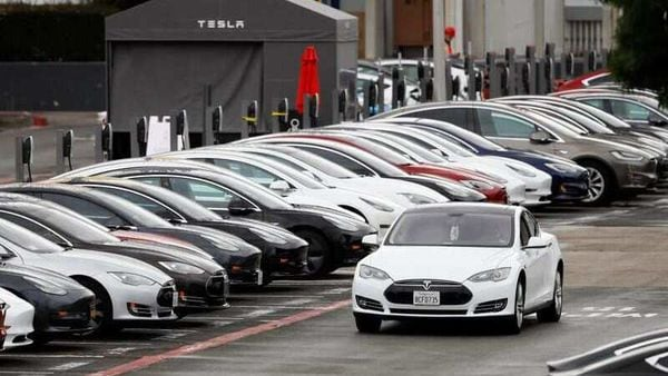 File photo - A Tesla Model S electric vehicle drives along a row of occupied superchargers at Tesla's primary vehicle factor in California. (REUTERS)