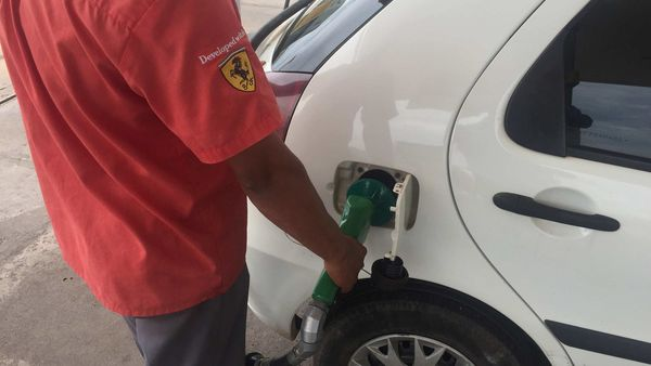 File photo - A gas station worker fills up a car's tank with ethanol in Cuiaba, Braziil. (REUTERS)