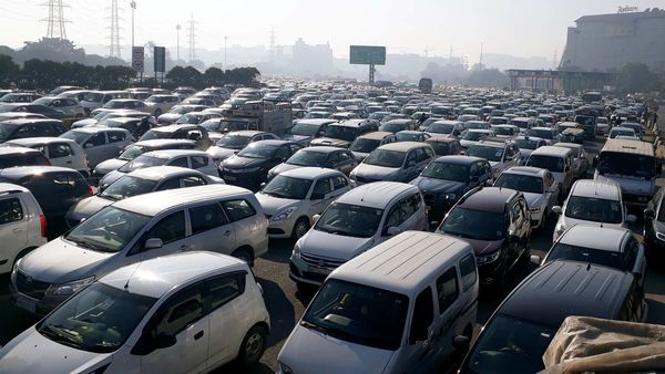 Heavy traffic jam at Gurugram-Delhi border as police personnel barricades the route amid the farmers protest, in Gurugram on Friday.