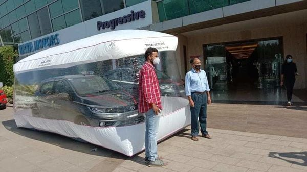 A new Tata Tiago placed inside a safety bubble before delivery. (Photo courtesy: Twitter/@TataMotors_Cars)