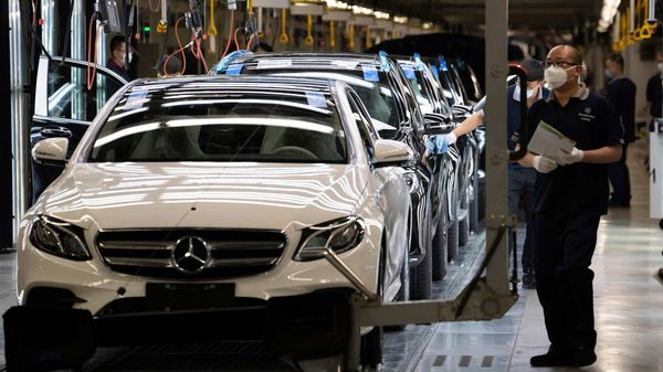 File photo - Workers inspect newly assembled cars at a Beijing Benz Automotive Co. Ltd factory in Beijing. (AP)