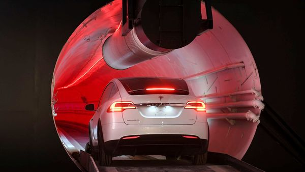 File photo of a Tesla test car going inside a tunnel transport system under Las Vegas.