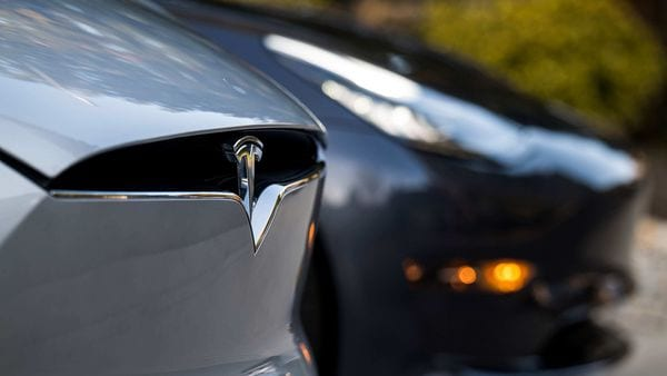A Tesla badge is displayed on a Model X electric vehicle. Photographer: David Paul Morris/Bloomberg (Bloomberg)