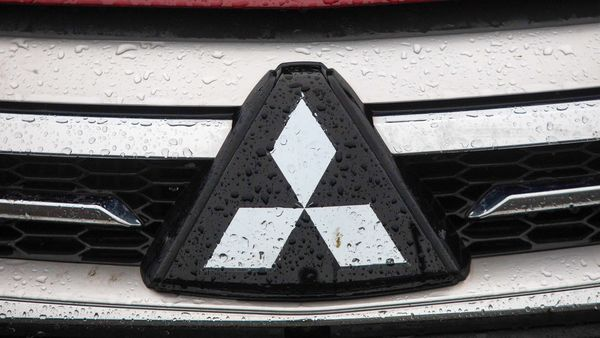 File photo of Mitsubishi Corp. badge on the front of a vehicle. (Bloomberg)