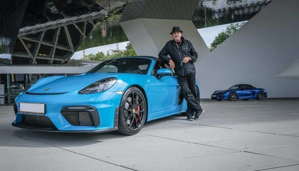 Ottocar J poses with his Boxster Spyder, only on of many Porsche in his garage.