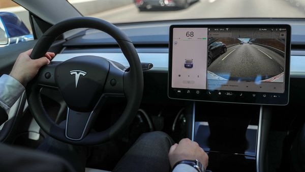The interior of a Tesla Model 3 electric vehicle (REUTERS)