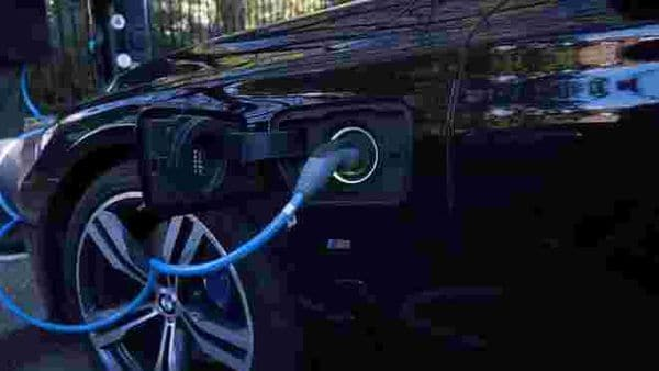 File photo: A driver plugs a cable into a Source power point to charge his electric car in London, Britain. (REUTERS)