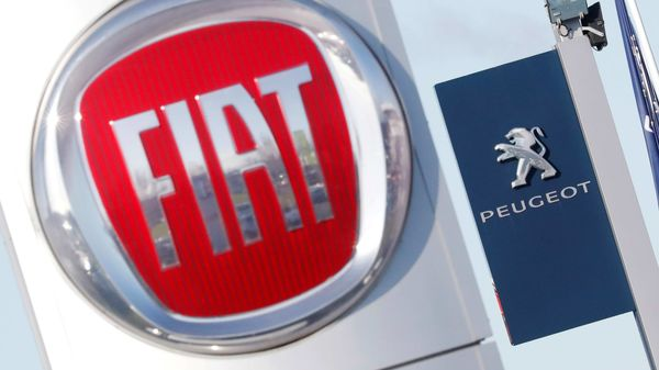 FILE PHOTO: The logos of car manufacturers Fiat and Peugeot are seen in front of dealerships of the companies in Saint-Nazaire, France. (REUTERS)