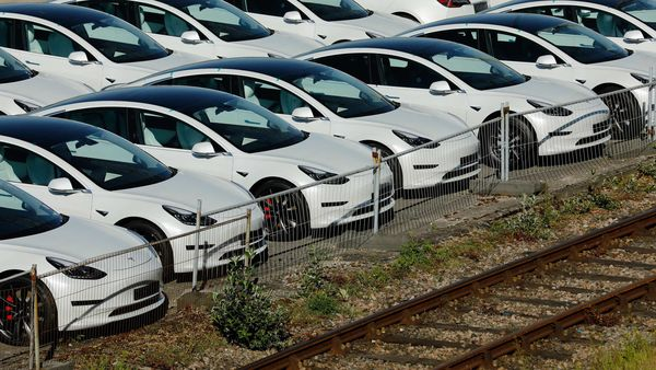 New electric automobiles, manufactured by Tesla Inc., sit on the dockside after being imported to the Port of Southampton in Southampton, UK. (File photo used for representational purpose) (Bloomberg)