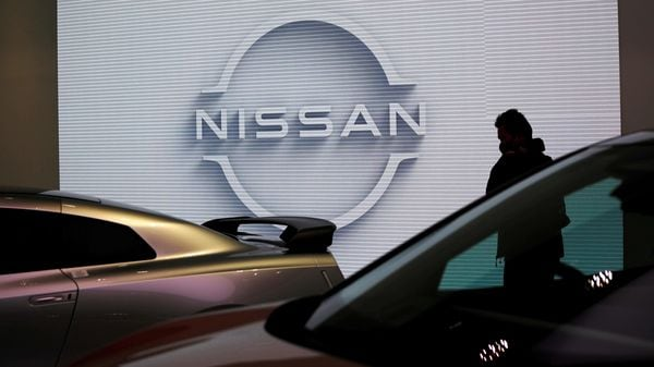 A visitor is seen at a Nissan Motor Corp. showroom in Tokyo, Japan. (File Photo) (REUTERS)
