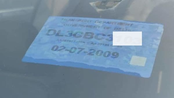 Colour coded sticker on the front windshield. The blue in this image denotes this is a petrol vehicle.