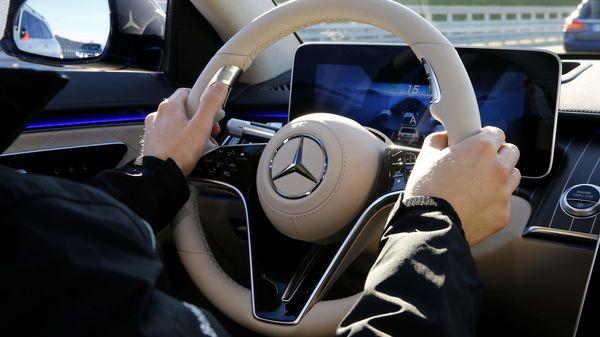 File photo of Daimler logo on steering wheel (REUTERS)