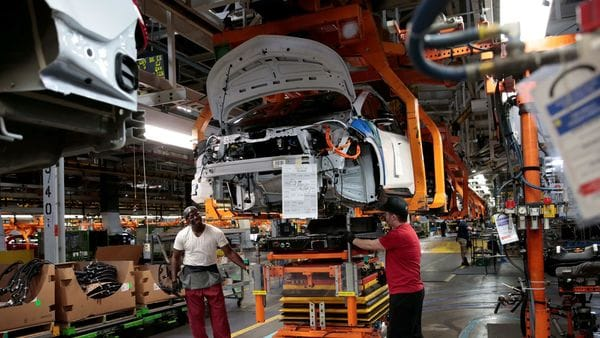 FILE PHOTO: General Motors assembly workers connect a battery pack underneath a partially assembled 2018 Chevrolet Bolt EV vehicle on the assembly line at Orion Assembly in Lake Orion, Michigan, U.S., March 19, 2018. REUTERS/Rebecca Cook/File Photo (REUTERS)