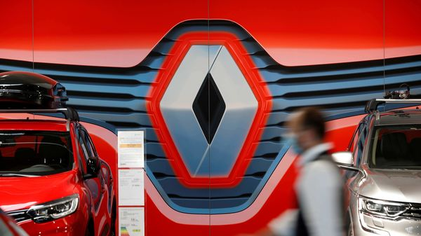 An employee walks past a logo of Renault at a dealership in France. (File photo) (REUTERS)