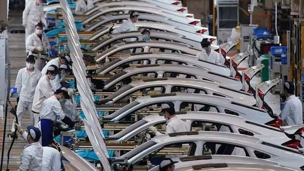 Honda employees work on a production line in China. (File photo) (REUTERS)
