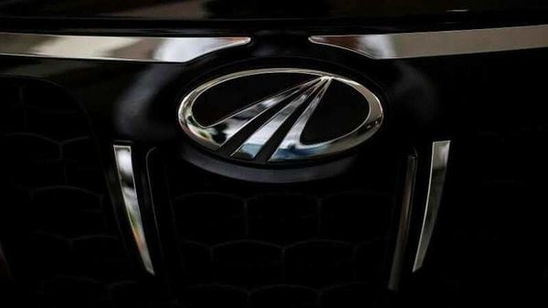 FILE PHOTO: The logo of Mahindra and Mahindra is seen on a car at a showroom in Mumbai, India. (REUTERS)