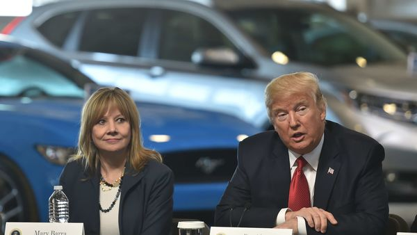 In this file photo former US President Donald Trump is seen with General Motors CEO Mary Barra. (AFP)