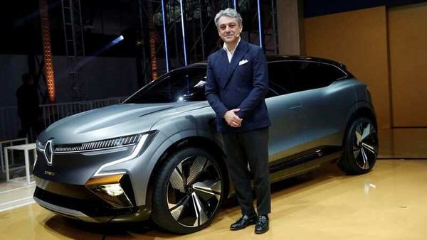 FILE PHOTO: Luca de Meo, Chief Executive Officer of Groupe Renault, poses in front of a Renault Megane eVision car during a news conference about Renault electric strategy during Renault eWays event in Meudon, France, October 15, 2020. REUTERS/Benoit Tessier/File Photo (REUTERS)