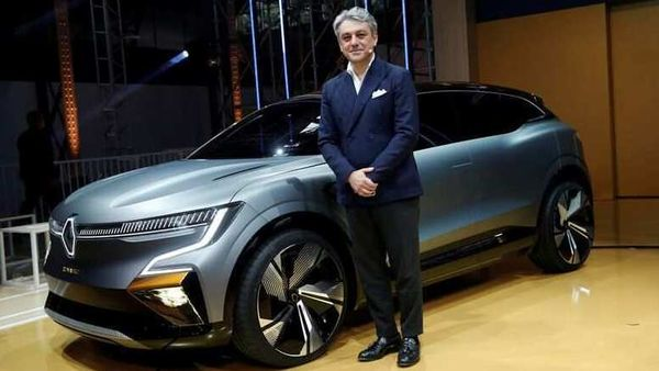 FILE PHOTO: Luca de Meo, Chief Executive Officer of Groupe Renault, poses in front of a Renault Megane eVision. REUTERS/Benoit Tessier/File Photo (REUTERS)