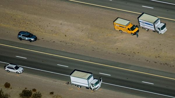 Damage to a truck is evident as the Nevada Highway Patrol works the scene of a fatal accident involving multiple bicyclists and a box truck along U.S. Highway 95 southbound near Searchlight, Nev., Thursday, Dec. 10, 2020. (L.E. Baskow/Las Vegas Review-Journal via AP) (AP)