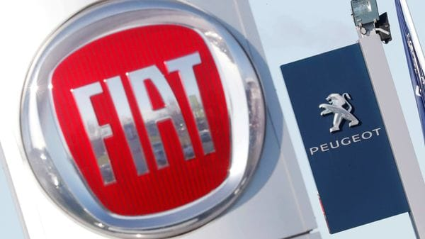 FILE PHOTO: The logos of car manufacturers Fiat and Peugeot (REUTERS)