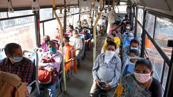 Passengers seen sitting next to each other in a bus in Delhi. (File photo)