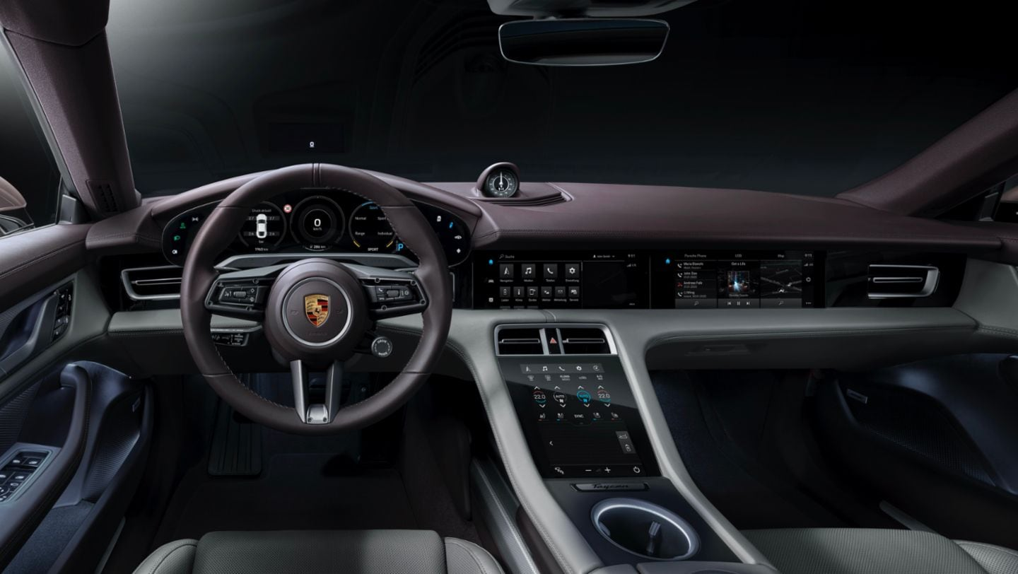 The cockpit of the Taycan has been designed in a fashion that places a clear focus on the driver axis. There is also a central 10.9-inch infotainment display and an optional display for the front passenger.