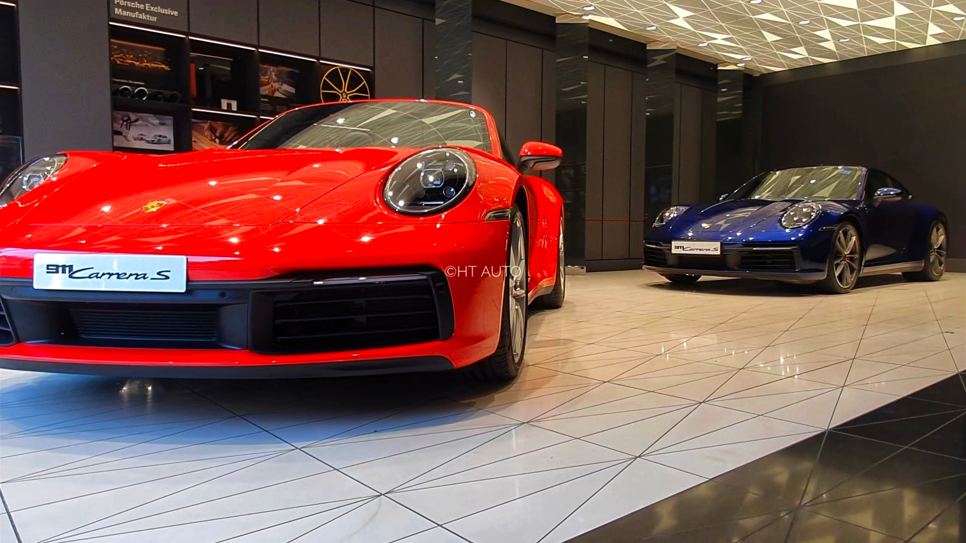The showroom has space enough to showcase two cars at a time. But if one is a Porsche fan, he can spend quality time being lost at the carmaker's history carefully framed across the showroom. (Sabyasachi Dasguptga/HT Auto)