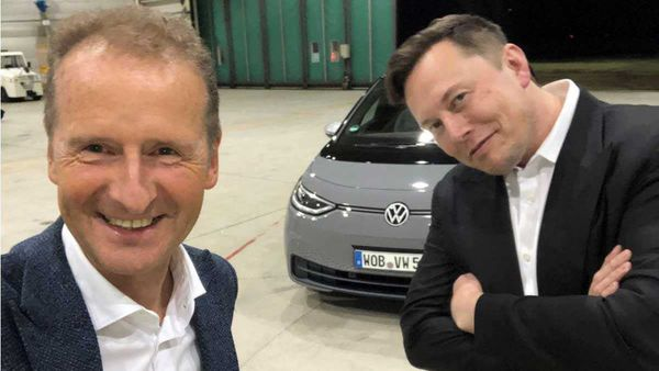 Volkswagen CEO Herbert Diess seen with Tesla CEO Elon Musk with a VW ID.3 electric vehicle. (Photo courtesy/LinkedIn: Herbert Diess)