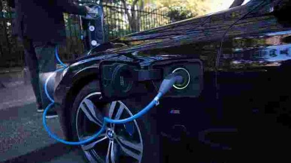 Representational File photo: A driver plugs a cable into a Source power point to charge his electric car. (REUTERS)