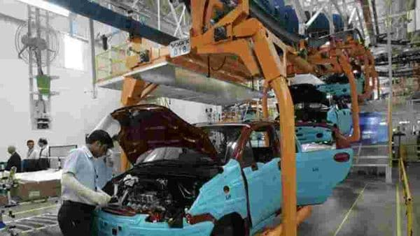 A worker assembles a vehicle on the assembly line at the plant of General Motors in Talegaon. (File photo)