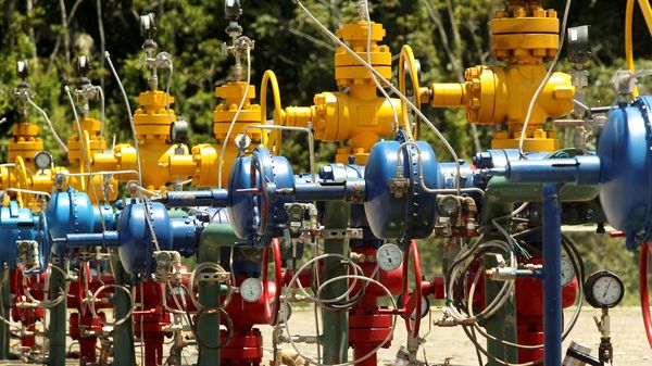 FILE PHOTO: Wellheads painted in the national colours are seen at an oil rig of Ecuador's state oil company Petroamazonas.