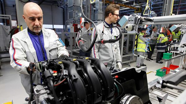 Employees of French carmaker PSA Peugeot Citroen work on the new engine EB assembly line at the company engines factory in Tremery. (File Photo) (REUTERS)