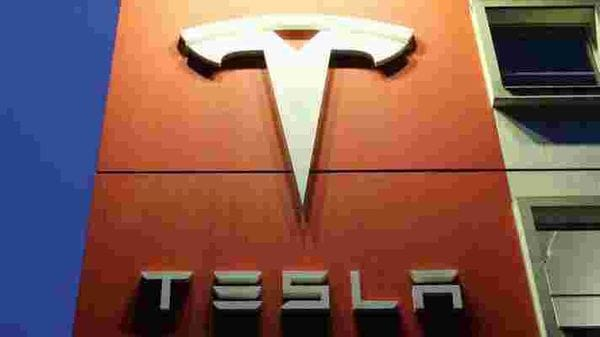FILE PHOTO: A logo of car manufacturer Tesla is seen at a branch office (REUTERS)