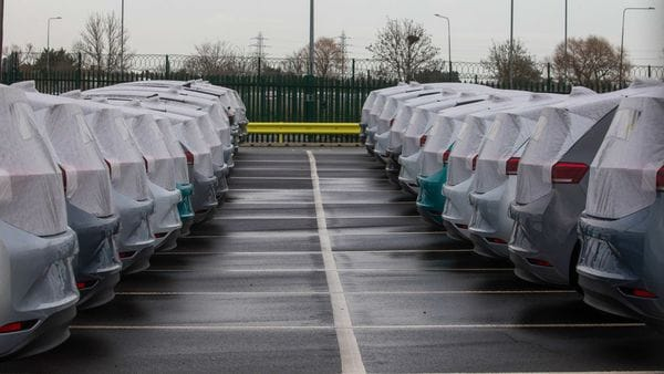 Parked cars covered in protective sheets at Peel Ports Ltd London Medway facility in Sheerness, UK. (Bloomberg)