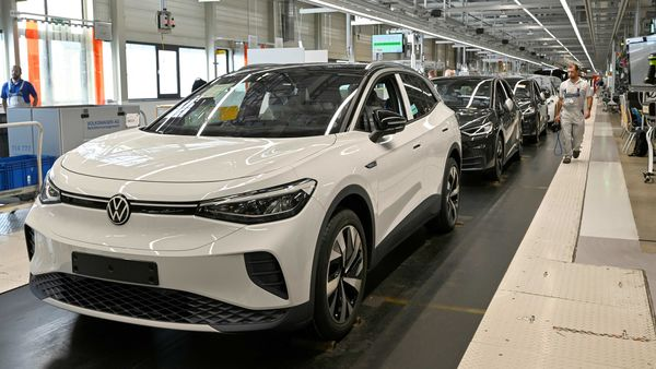 Technical employees work at the production line for the electric Volkswagen cars, model ID.3 and model ID. 4, in Zwickau, Germany. (File Photo) (REUTERS)