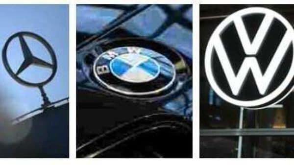Logos of Daimler, BMW and Volkswagen