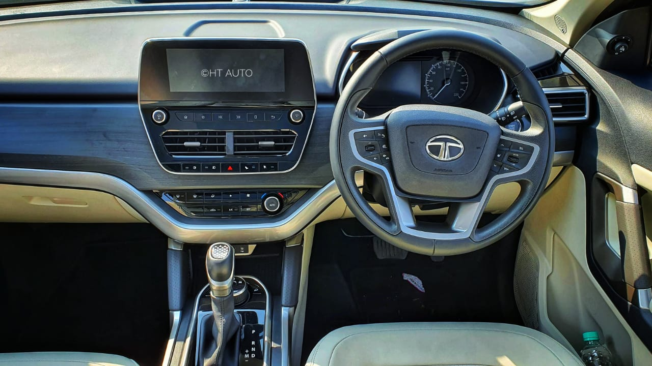 Inside, the 2021 Safari gets a new Ashwood dashboard, Oyster white colour theme, and three rows of stadium-style seating. There is leather wrapping on the steering wheel and gear knob which makes the cabin feel rich. (Image: Sabyasachi Dasgupta/ HT Auto)