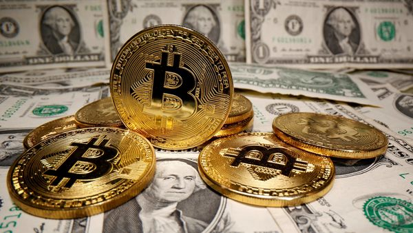 File photo - Representations of virtual currency Bitcoin are placed on US Dollar banknotes. (REUTERS)