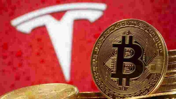 Representations of virtual currency Bitcoin are seen in front of Tesla logo in this illustration taken, February 9, 2021. REUTERS/Dado Ruvic/Illustration/File Photo (REUTERS)