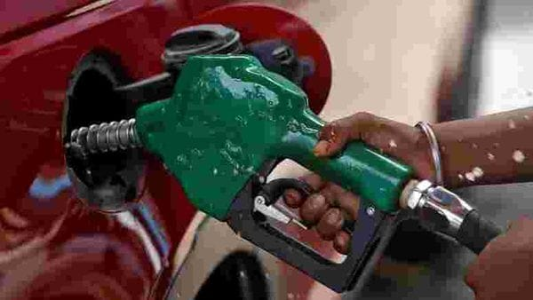 Representational image: A worker holds a nozzle to pump petrol into a vehicle at a fuel station in Mumbai. (REUTERS)