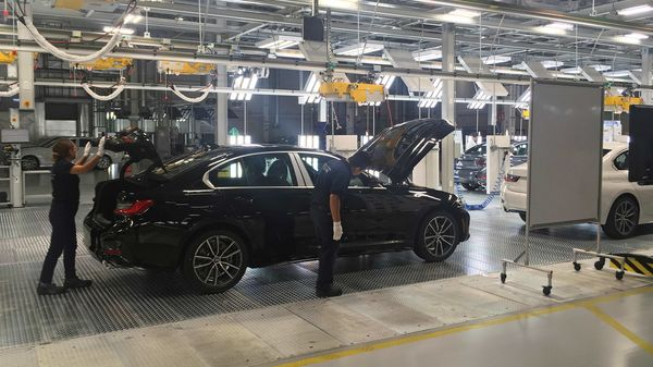 FILE PHOTO: Employees work on a BMW 3 Series car during a media tour at the new plant of German automaker BMW in San Luis Potosi, Mexico June 6, 2019. REUTERS/Sharay Angulo/File Photo (REUTERS)