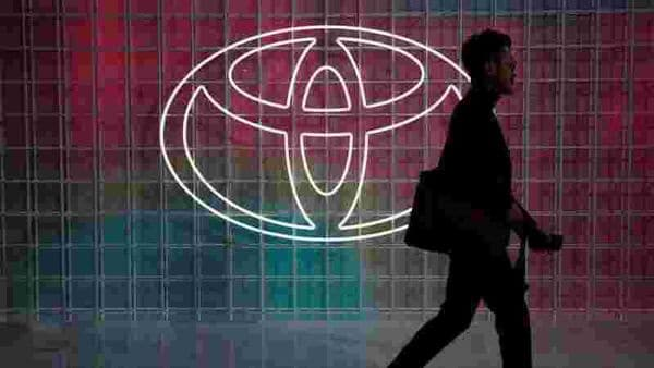 FILE PHOTO: A man walks past a Toyota logo at the Tokyo Motor Show, in Tokyo, Japan (REUTERS)