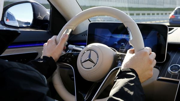 An employee of Daimler steers a new Mercedes-Benz S-Class limousine at the company's test center near Immendingen, Germany. (REUTERS)